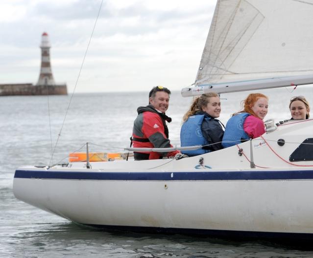 Paralympian sailor John Robertson with L-R Ellie Lyall, Caitlin Buddy, Sophie Jordan.