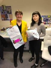 Maree with Hailey from Orkney Rape Crisis centre unpacking donations