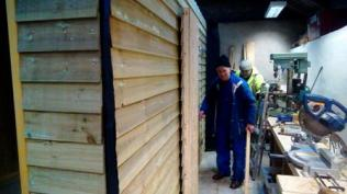 Peter putting the finishing touches to his doors