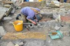 excavating the large hearth located in the Wag Structure