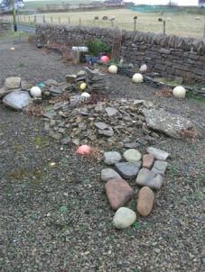 garden stones and beach debris Bell