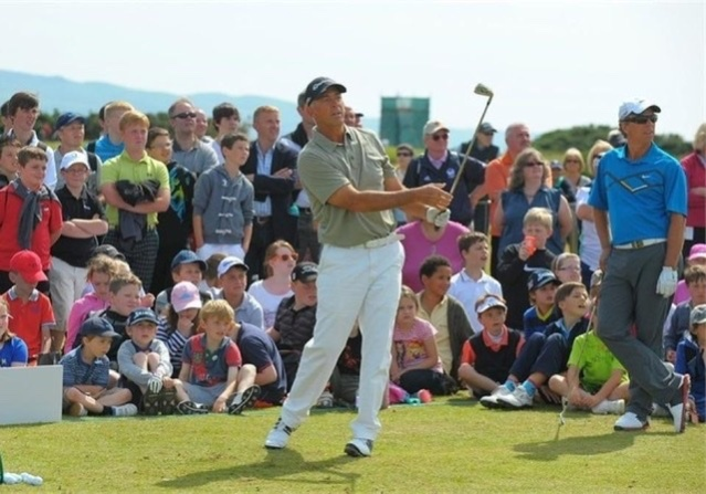Watching Tom Lehman (centre) hitting a 1 iron at Turnberry . Bobby Clampett (right)
