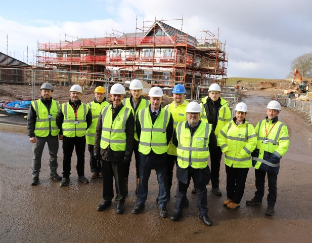 Current construction assessors pictured with key representatives from ESP and CITB at a Taylor Wimpey Site in Cambuslang