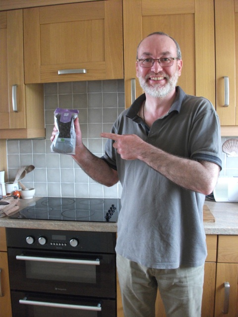 Mike Bell in kitchen with raisins