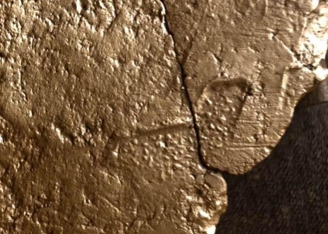 Close up of textile impression under RTI. Photo UHI Archaeology Institute