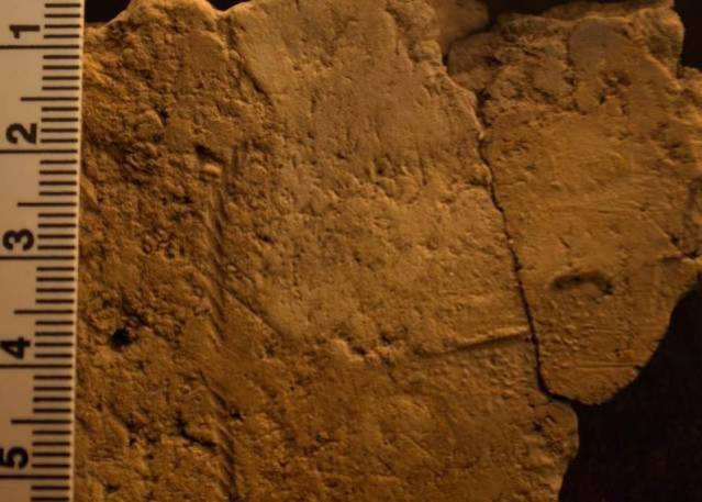 Ness of Brodgar Cord impression with textile to the right. Photo UHI Archaeology Institute