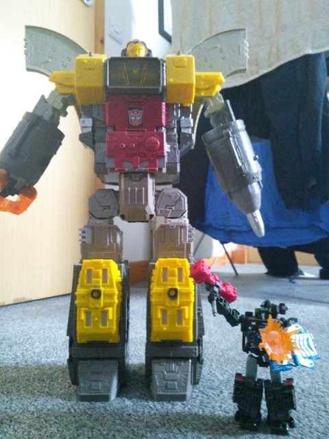 WFC Siege Omega Supreme Transformer Robot mode with Hound for scale